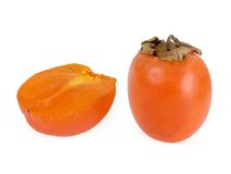 Persimmons. Juicy persimmons on a white background Royalty Free Stock Photo
