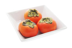 Persimmons in Bowl Royalty Free Stock Photo