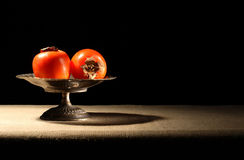 Persimmons In Bowl Royalty Free Stock Images