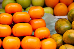 Persimmons in Cambodian Market Stock Photo