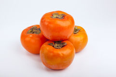 Persimmons close up, with white background, Royalty Free Stock Photos