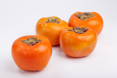 Persimmons close up, with white background, Stock Photography