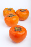 Persimmons close up, with white background, Stock Image