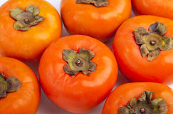 Persimmons close up, with white background, Royalty Free Stock Image