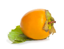 Persimmons with green leaves Stock Photography