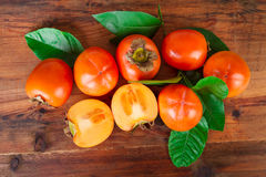 Persimmons kaki fruits on rustic table. Top view Stock Photo