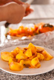 Persimmons On White Dish Stock Images