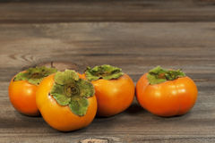Persimmons Rustic Wood Surface Stock Photo