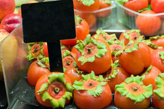 Persimmons sale Royalty Free Stock Images