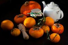 Persimmons, tangerines, πορτοκάλια και κολοκύθα Στοκ Εικόνες