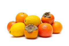 Persimmons, tangerines and lemons  on white background Royalty Free Stock Photography