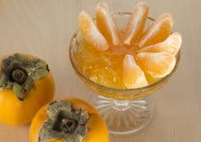 Persimon- och tangerindriftstopp Royaltyfria Bilder