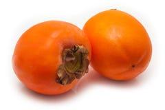 Persimon ou fruit de Sharon sur un fond blanc de studio Image stock