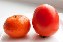 Persimone und Tangerine Lizenzfreie Stockfotos