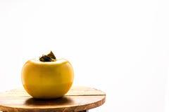 persimonfrukt på vit Arkivfoto