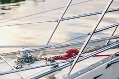 Narrow nose of the boat with handrails. Persistent barriers in stainless steel on the nose yachts stock photo