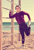 Persistent female training  at sea beach Royalty Free Stock Images