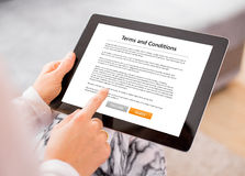 Person accepting terms and conditions on tablet Stock Images