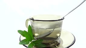 Person adding an effervescent tablet in a cup of tea Stock Images