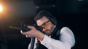 Person aiming with a rifle at a range, close up. stock video
