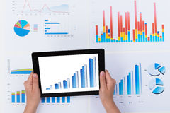 Person Analyzing Financial Graph On Digital Tablet Royalty Free Stock Photography