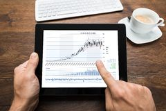 Person Analyzing Graph On Digital Tablet Stock Photos