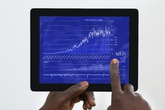Person Analyzing Graph On Digital Tablet Royalty Free Stock Photos