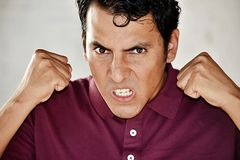 Person And Anger. A handsome adult hispanic man Royalty Free Stock Image