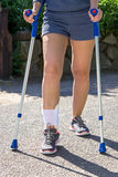 Person with Ankle Brace Walking with Crutches royalty free stock photography