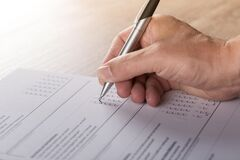 Person Answering Test Paper Stock Photography