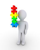Person balancing puzzle pieces. 3d person is holding vertically four different puzzle pieces Royalty Free Stock Images
