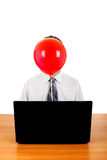 Person with Balloon behind Laptop Royalty Free Stock Images