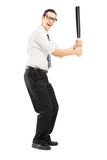 Person with a baseball bat prepared to strike. Full length portrait of a person with a baseball bat prepared to strike isolated on white background Stock Photos