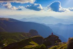 Person in the beautiful mountain landscape of Ceahlau Stock Images