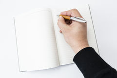 A person beginning to write Royalty Free Stock Image