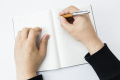 A person beginning to write Royalty Free Stock Photography