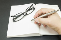 A person beginning to write Stock Photography