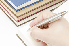 A person beginning to write Stock Image