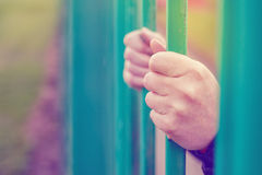 Person behind bars Royalty Free Stock Photography