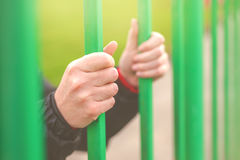 Person behind bars Stock Images