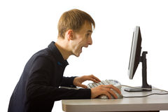 A person behind the computer Stock Image
