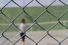 Person behind a metal fence Stock Photos