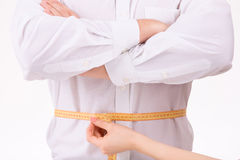 Person is being measured by measuring tape Royalty Free Stock Photography