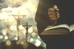 Person with bible and rosary Stock Photography