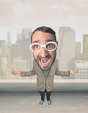Person with big head. Funny guy with big head, cityscape background Stock Images