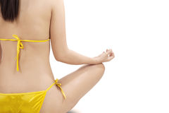 Person with bikini doing meditation Stock Photos