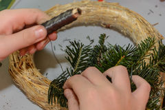 Person binds Advent wreath Stock Image