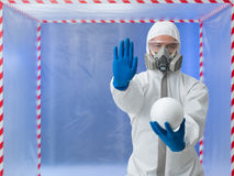 Person in biohazard suit warns against contaminantion Stock Photography
