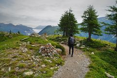 Person in Black Backpack Walking Stock Image