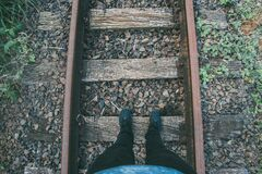 Person in Black Fitted Jeans and Sneakers Stepping on Wooden Trail Way Stock Photography